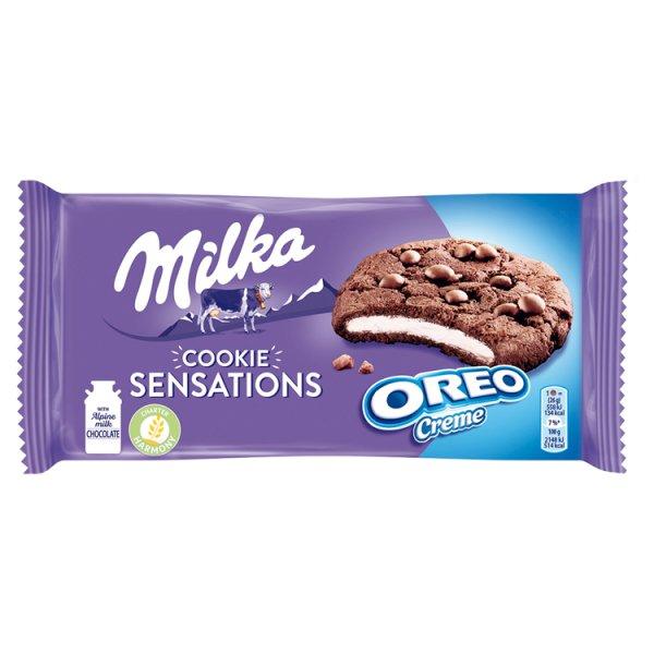 Milka Cookie Sensations Ciastka kakaowe z kawałkami czekolady i nadzieniem o smaku waniliowym 156 g